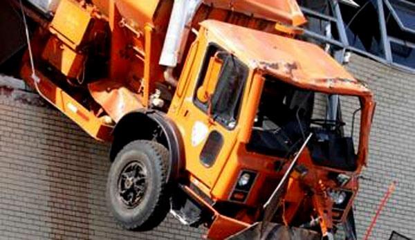 Truck Crashes Through Top Floor, Narrowly Avoids Hitting the Street