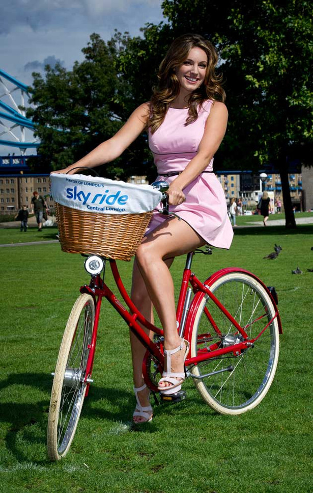 Kelly Brook Rides a Bicycle… in High Heels
