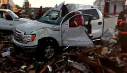 Watch This Truck Pull Itself Out of Wreckage on Three Wheels