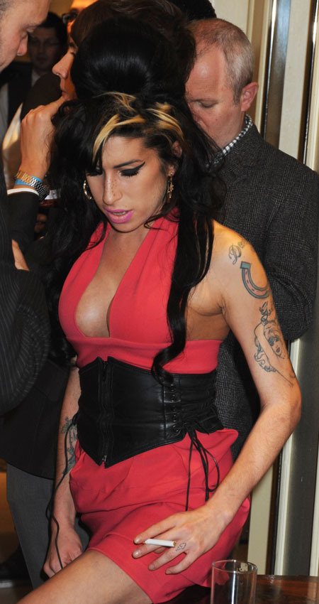 Amy Winehouse's Fake Breasts Have Officially Arrived
