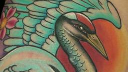 Ty'Esha Triumphs With A Thrilling Crane Tattoo