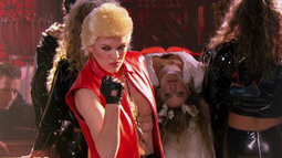 Milla Jovovich Performs 'White Wedding' By Billy Idol